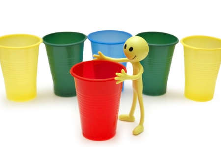 Figure of Smiley and colourful cups photo