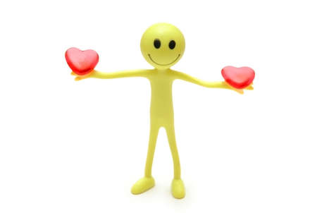 Smiley holding two red hearts in hands photo