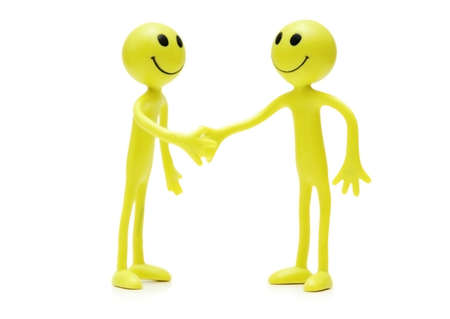 Figures of smilies shaking hands Stock Photo