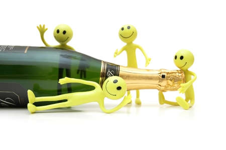 sucessful: Figures of Smiley around a bottle of champagne