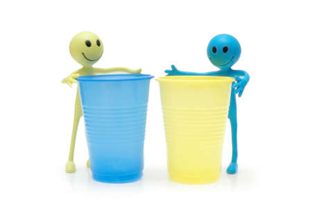 Two figures of Smileys and two plastic cups photo