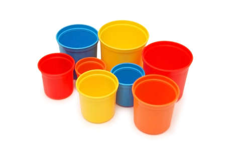 Various coloured cups isolated on white photo