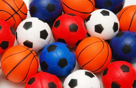 Selection of basketballs and footballs photo