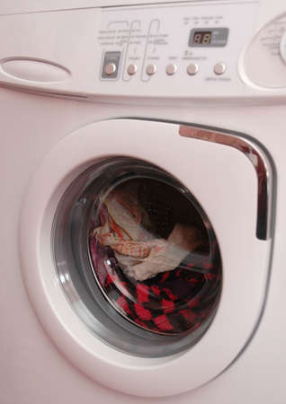 Working washing machine with clothing Stock Photo
