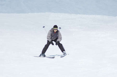 Skier skiing down the hill photo