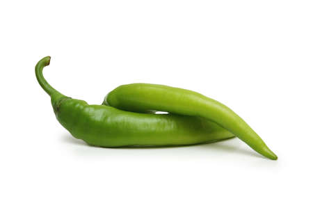 Two green chillies isolated on the white background