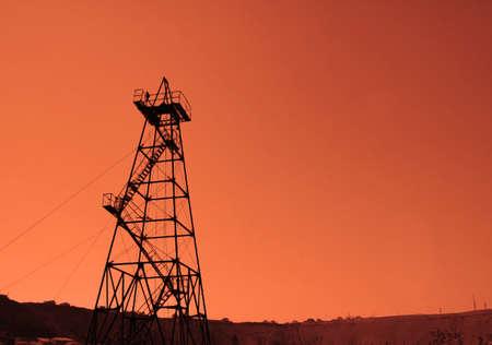 baku: Oil derrick during sunset - Azerbaijan, Baku