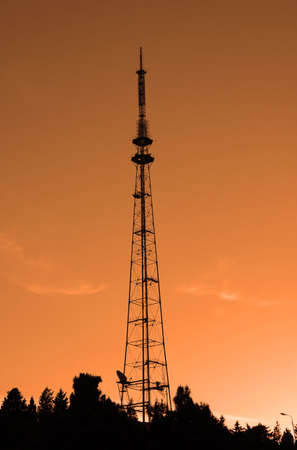 Old TV tower in Baku, Azerbaijan during sunset photo