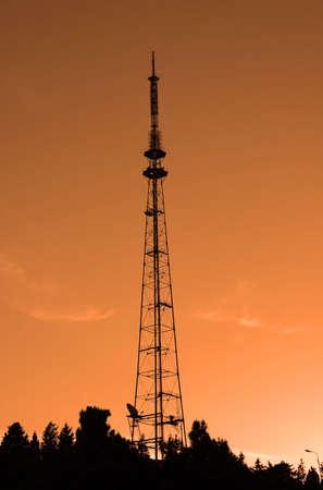 Old TV tower in Baku, Azerbaijan during sunset photo