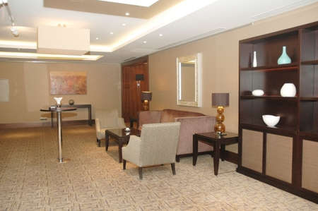 desk area: Lobby of the hotel with sofas and shelves