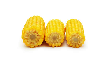 shucked: three corn cobs isolated on the white Stock Photo