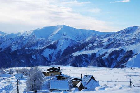 Mountains and small village in winter - Georgia, Gudauri Stock Photo - 681068