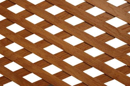 Enrejados de madera con agujeros en forma de rombo  Foto de archivo - 681030