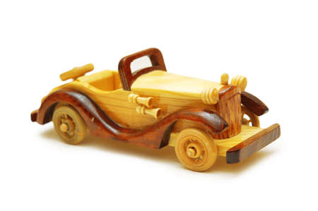 Wooden model of retro car isolated on white photo