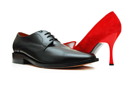 Black male shoe and red female shoe isolated on white photo