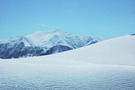 Snowdrift in bright winter day - Georgia, Gudauri Stock Photo - 693564