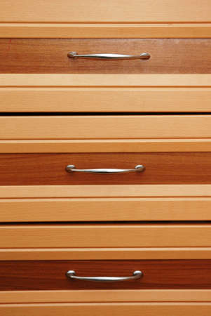 Set of three wooden drawers photo