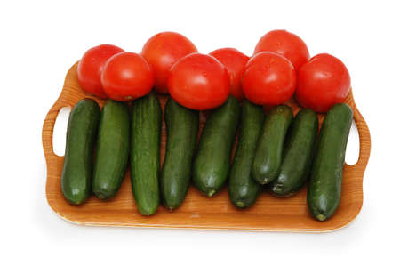 Tray with cucumbers and tomatos isolated on white Stock Photo - 693553