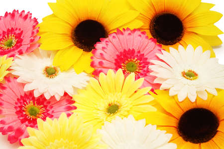 Various flowers (red, white, pink) arranged as background photo