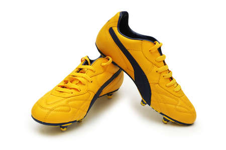 Yellow football boots isolated on the white photo