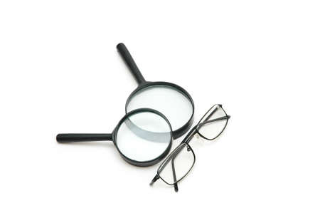 Magnifying glasses and reading glasses isolated on white photo