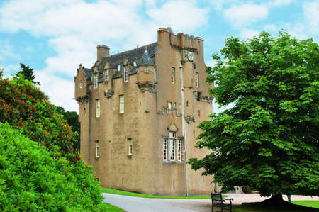 macbeth: Scottish castle between the trees in summer day