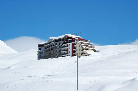 Big hotel at the mountain top covered with snow Stock Photo - 730356