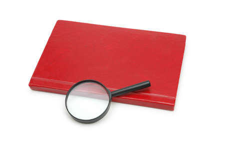 Magnifying glass over the red book isolated on white photo
