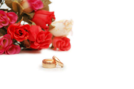 Two wedding rings and flowers at the background Stock Photo - 730310
