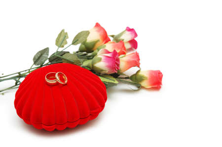Flowers, heart-shaped box and wedding rings isolated on white Stock Photo - 730309