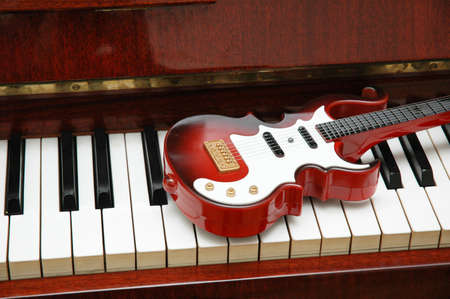 Guitar on the piano keys photo