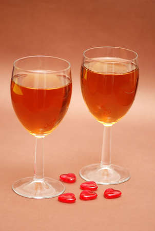 Two wine glasses and heart shapes photo