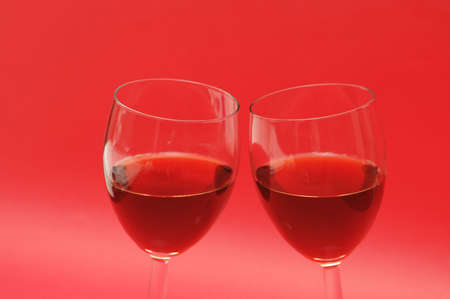 Two wine glasses against the red background Stock Photo - 730249