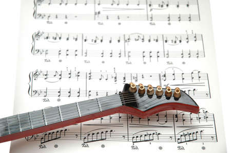 songwriter: Rock guitar over the sheet of printed music