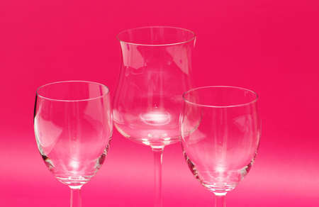 Three wine glasses against the red background Stock Photo - 738989
