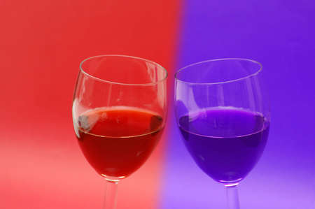 Two wine glasses against the red background photo