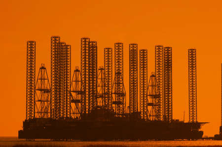 baku: Offshore oil rig at shallow waters during sunset
