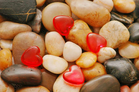 red pebble: Pebbles at the background and red heart shapes