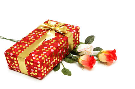 Gift box and bunch of flowers isolated on white Stock Photo - 765128