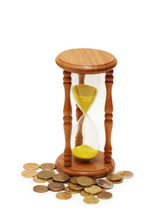 Time is money concept - hourglass and coins photo