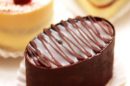 Topping of chocolate cake of oval shape photo
