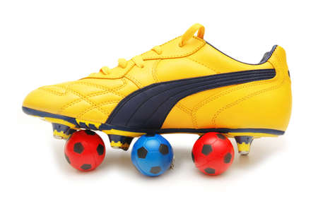 footware: Yellow soccer footwear and color footballs isolated on white  - more footware in my portfolio
