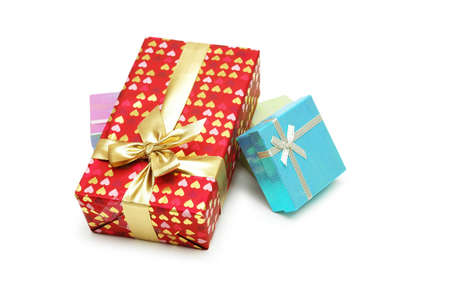 Gift boxes with shiny ribbons isolated on white photo