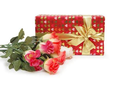 Gift box and bunch of flowers isolated on white photo