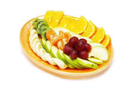Fruit salad in the plate isolated on the white photo