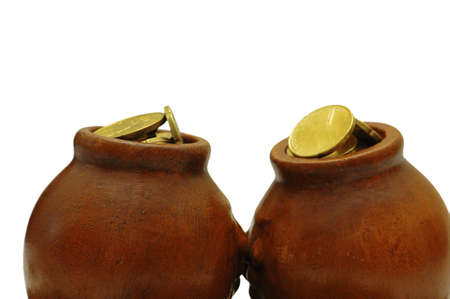Two clay pots with golden coins isolated on white photo