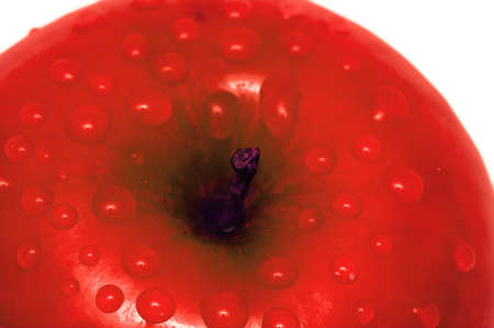 Close-up of an apple with water drops photo