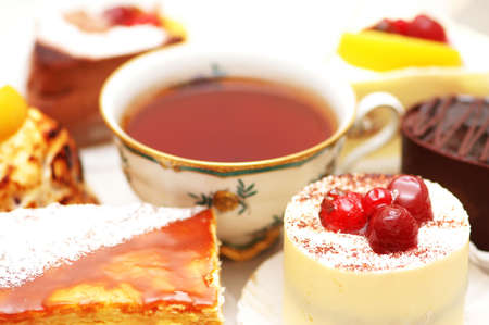 Sweet cake with berries and a cup of tea Stock Photo - 778094