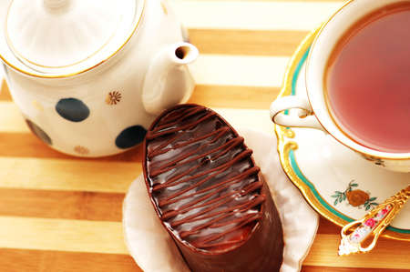 Cup of tea, chocolate cake and pot - view from the top Stock Photo - 778091