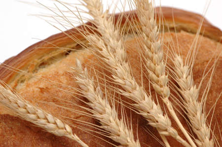 Wheat ears and bread loaf isolated on white Stock Photo - 778063